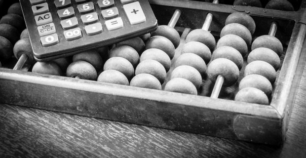 Abacus and calculator - copyright: junce