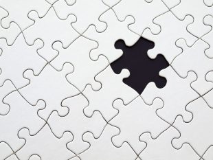 grey jigsaw with one piece missing