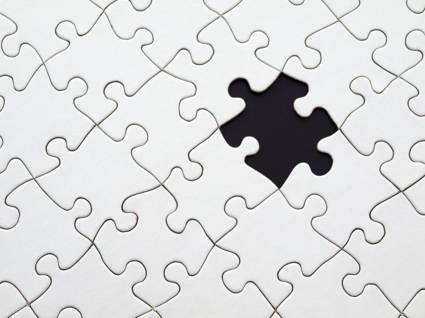 grey jigsaw with one piece missing