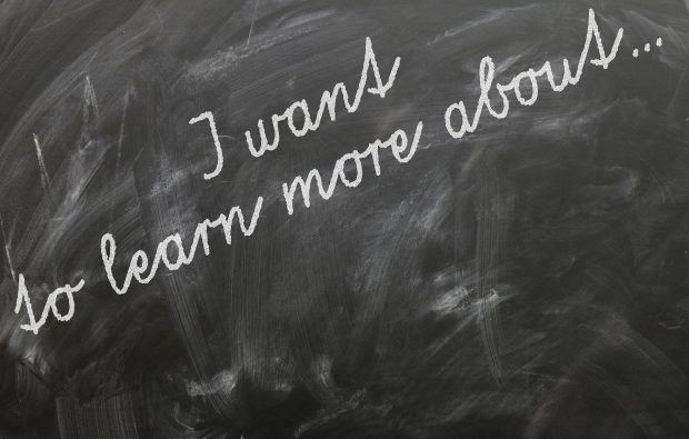 blackboard with words 'I want to learn more about'